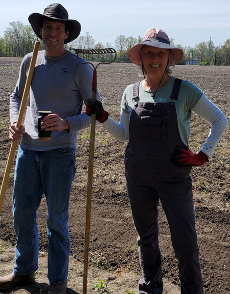 The caretakers of Sackett Farm working in the field